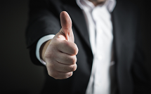 An image of a business man's thumb pointing up